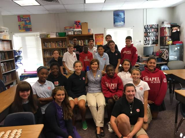 """Mindy Corporon, founder of giveSevenDays.org shares the message """"Make a Ripple, Change the World!"""" with seventh-graders from The Chapel School in Bronxville."""