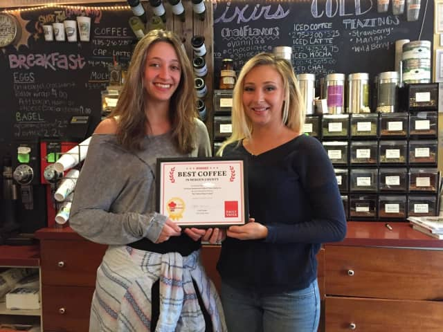 Cool Beans employees Kim Pfeifer, left, and Grace Prisco accept the DVlicious award.