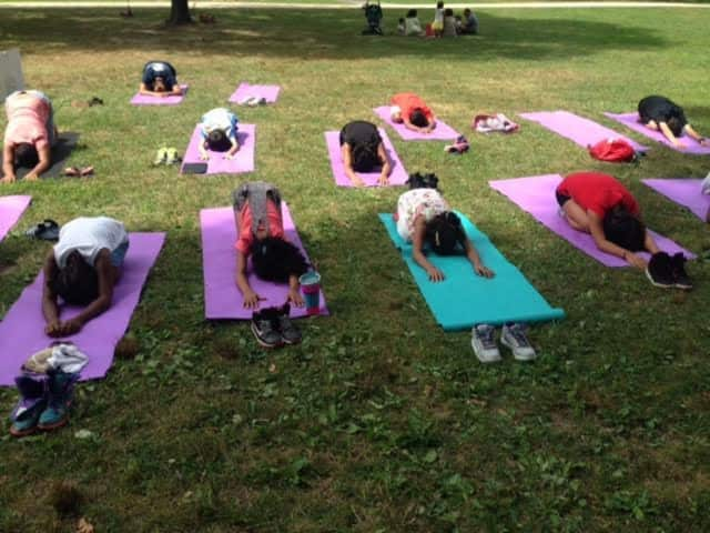 Yogis of all ages are welcome to breathe, stretch and relax at the Yoga Under The Stars event.