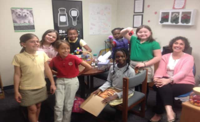 Guidance counselor Cathy Price with students at a lunch bunch in the 2014-15 school year.