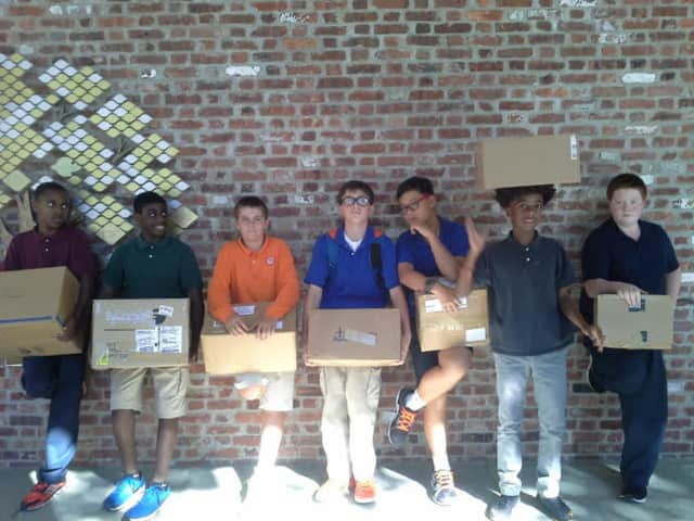 Chapel School students with packages earmarked for Syrian refugee children.