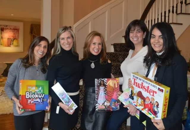 Westchester Jewish Community Services board members and event hosts, from left, Sarah Kayle, Nina Ross, Linda Plattus, Loretta Rosenbaum and Suzanne Yearley