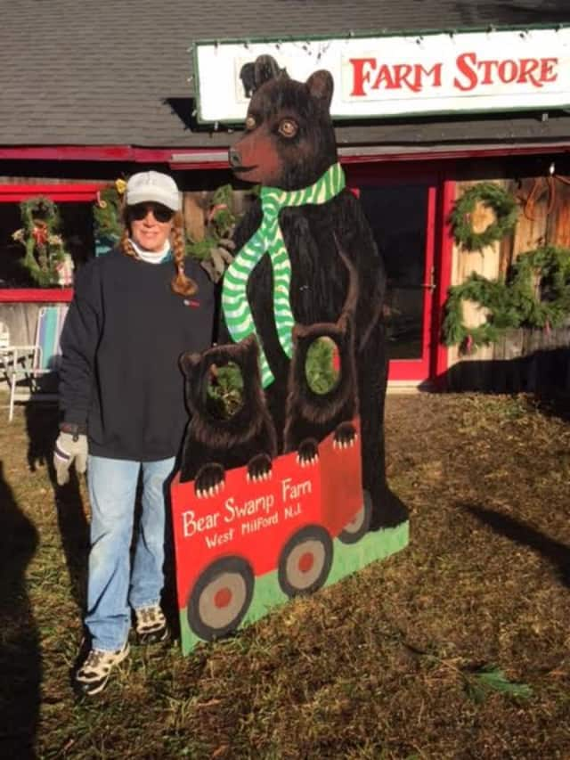 Allison Hosford's sister Peggy Masce in front of the Bear Swamp gift shop with the bear she created.