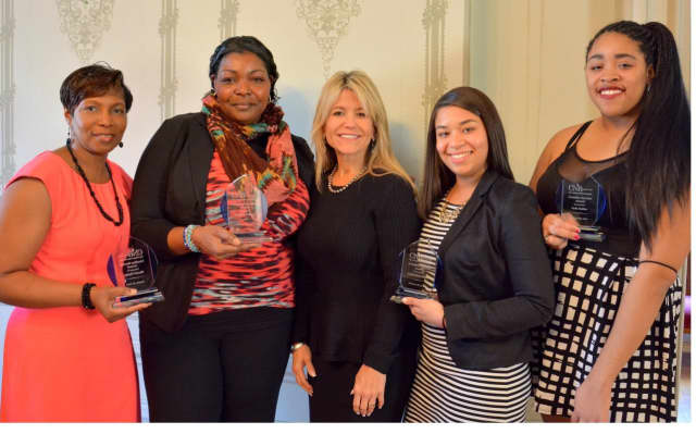 Students from The College of New Rochelle who received Ursuline Service Awards (left to right) Sheryl Clarke SNR'16; Andrea Fobbs SNR'13 GS'15; Judith Huntington, President of The College of New Rochelle; Catherine Pena SN'16; and Jade Sailor SAS'18.