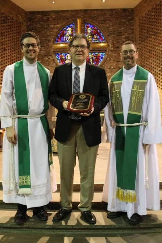 James Dhyne, principal of The Chapel School in Bronxville, was presented with The 2015-16 Pro Deo Et Schola Award on Sunday.