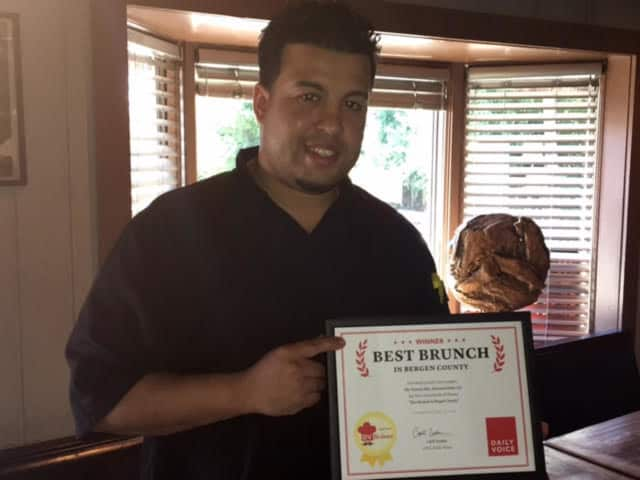 "Chef David ""Davey"" Morales of Twisted Elm in Elmwood Park accepts the DVLicious award for Bergen's ""Best Brunch."""