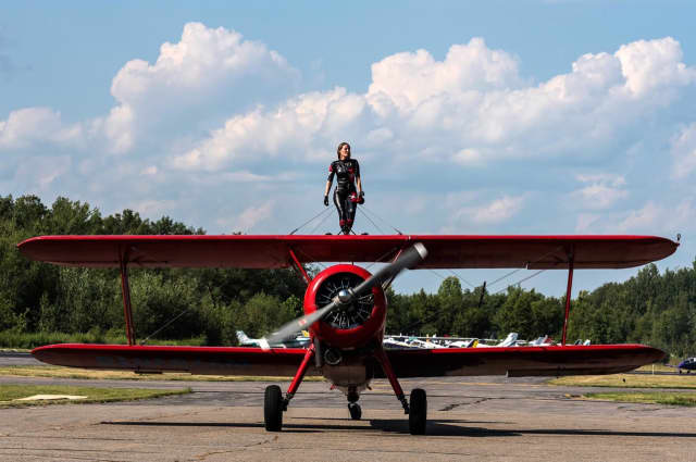 A wing-walker is shown at the 2015 Greenwood Lake Air Show.