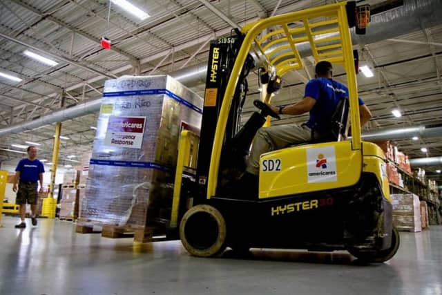 Workers in the Americares distribution center in Stamford prepare a shipment of medicine and supplies for Puerto Rico.