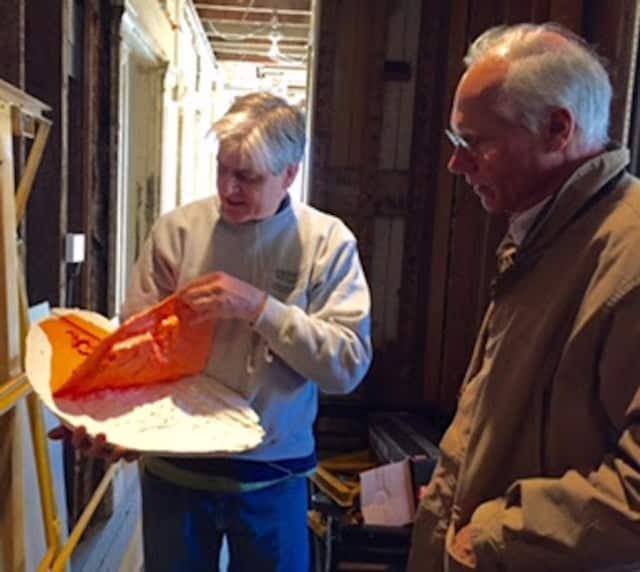 Bruce MacDonald shows Jim Kelsey restoration progress at Jay Estate in Rye.