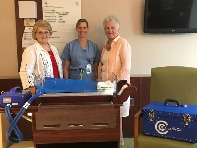 The Cuddle Cot donation at the Danbury Hospital Family Birth Center, from left: Janet Byrnes, Upper Room Thrift Shop volunteer), Michele Rybos, RN, Danbury Hospital Family Birth Center, Dorrie Johnson, Upper Room Thrift Shop volunteer.
