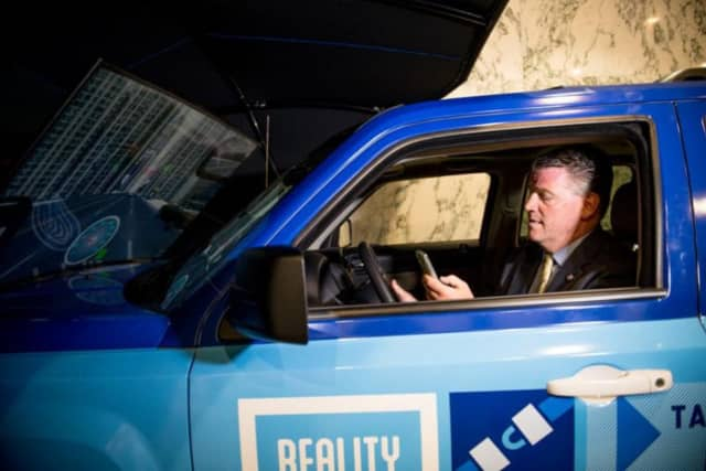 Sen. Terrence Murphy attempts to navigate the road in Allstate's Reality Rides demo.