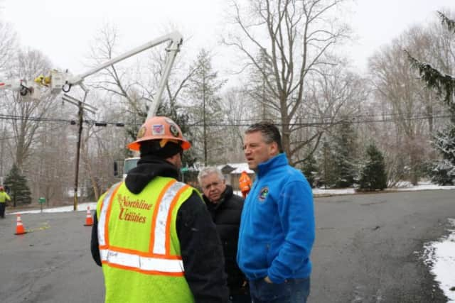 State Sen. Terrence Murphy and Somers Supervisor Rick Morrissey are briefed on power restoration efforts by a crew worker from Northline Utilities in Somers.