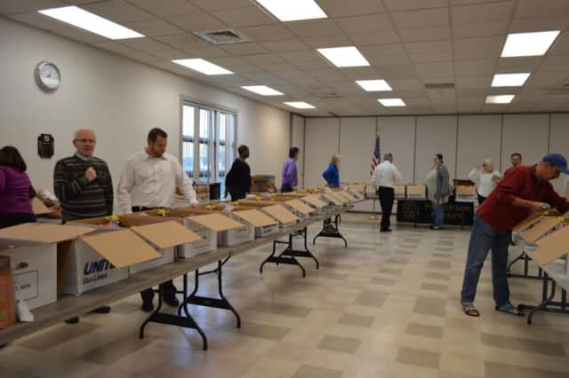 The Patterson Rotary assemble Thanksgiving dinner baskets for Putnam County families.