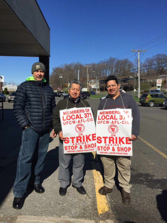 Store employees, Sabino Hernandez, Wilson Segarra, Manuel Pauta hold signs outside Stop & Shop, located at 44 Lake Ave. Ext. in Danbury on Tuesday morning, April 16, day six of the workers' strike.