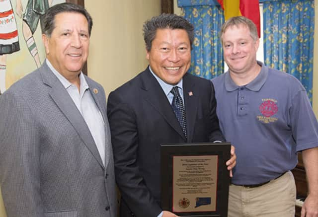 Uniformed Professional Fire Fighters Association of Connecticut President Peter Carozza, state Sen. Tony Hwang and Fairfield Firefighters Association Local 1426 Executive Board President Bob Smith at the ceremony.
