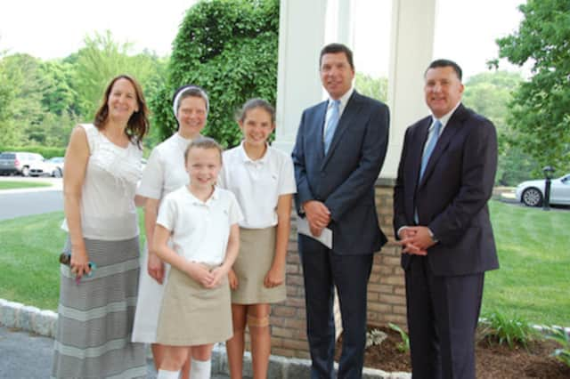 From left, Dr. Jo-Ann Maroto-Soltis; Sister Colleen Therese Smith; Julia Cirone: Grace Soltis; Dr. John Murphy, President and Chief Executive Office, Western Connecticut Health Network; and Anthony Cirone.