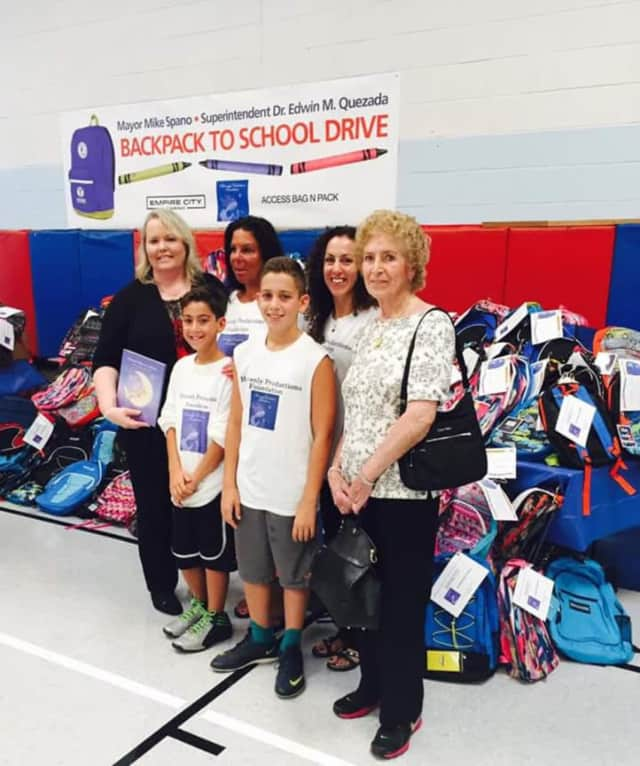 Heavenly Productions, an Armonk-based nonprofit, donated hundreds of backpacks to needy Yonkers schoolchildren. From left at P.S. 13, are: Dr. Kathy Reilly Fallon, Sheryl Nolletti, Matthew Kalian, Christian Kalian, Michelle Kalian and Anne Reilly.
