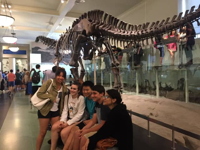 Pelham students pose in front of a dinosaur at the American Museum of Natural History on the recent field trip.