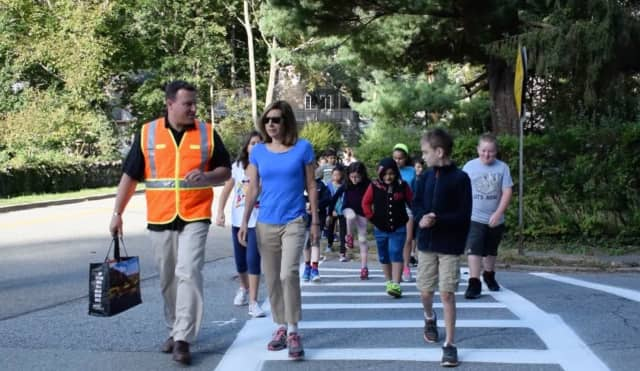 Pierre Van Cortlandt Middle School Assistant Principal Michael Plotkin and Croton-on-Hudson Village Manager Janine King rguided students on a safe walk to school.
