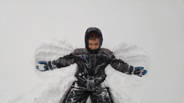 Making snow angels.