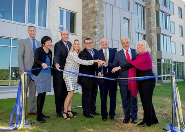 Officials gather at Pace University to cut the ribbon on Elm Hall on Thursday.