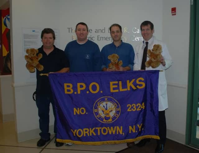 Left to right, Elk members Robert Kramer, Paul Egan, Steve Brawitsch, and Dean Straff, M.D., of White Plains Hospital