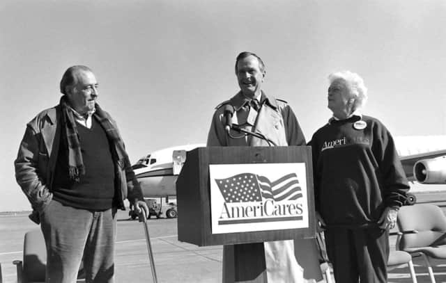 President George H.W. Bush on the tarmac in Houston with First Lady Barbara Bush and Americares founder Bob Macauley (left) after a December 1993 aid mission to Croatia.