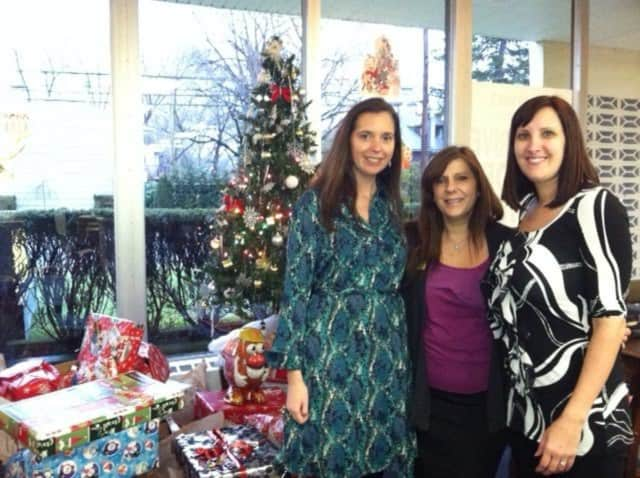 Nicole McQuillen, Susan Devine, and Laura Del Tufo help coordinate this year's toy drive in Fair Lawn.