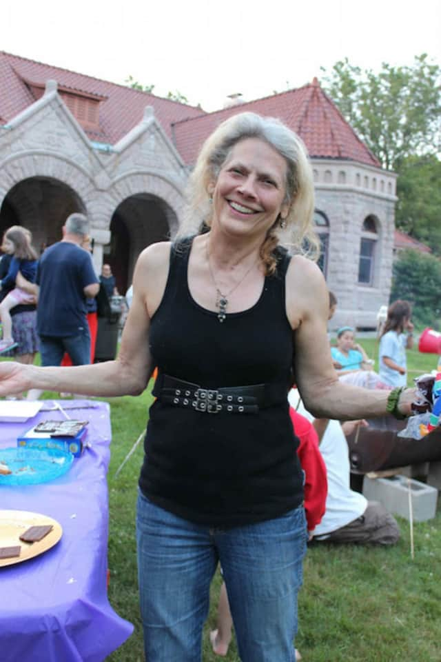 Susan Ei is known for creating the Annual Potluck Supper and Campout, the Easter Egg Roll, and the 4th of July Bike Parade & Lawn Games at the Pequot Library.