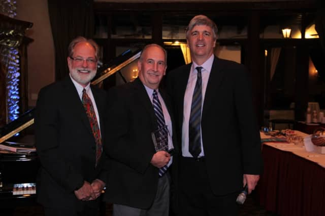 Pictured are David Freshwater, chairman Watermark Retirement Communities, and David Barnes, president and chief executive officer, presenting the award David Goldsmith.