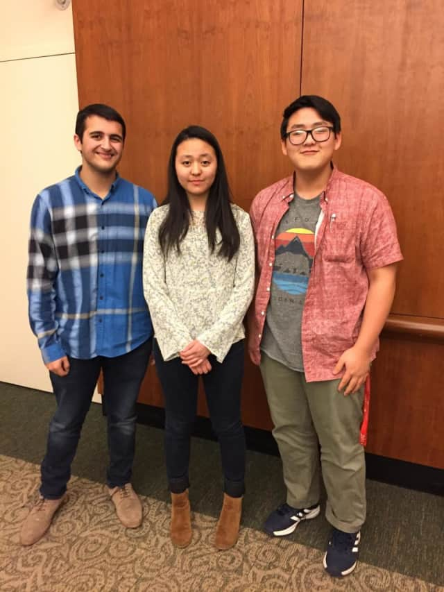 Pelham Memorial High School junior Emily Xue, middle, won first place in the sixth annual Brain Bee competition held Wednesday, Feb. 1, at Burke Rehabilitation Hospital in White Plains.