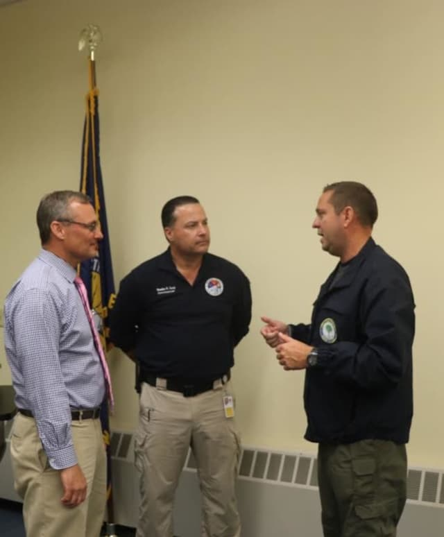 (Left to right): Woodbury Common Premium Outlets General Manager Dave Mistretta, Orange County Commissioner of Emergency Services Brendan Casey and Orange County Executive Steven M. Neuhaus