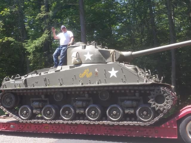 Bud Walker atop his World War II vintage Sherman tank, which will be on display with other Army vehicles at the Historic and Military Vehicles Show at Lasdon Park, Arboretum and Veterans Memorial, Saturday and Sunday, July 1 and 2.