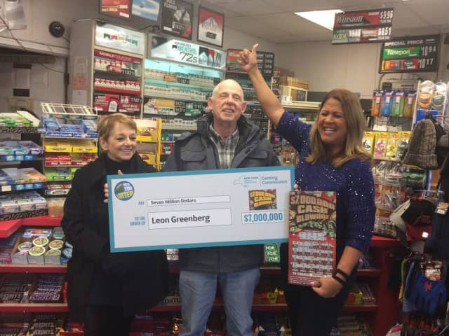 Ossining resident Leon Greenberg and his wife, Karin, at left, are introduced as $7 million New York State Lottery winners.