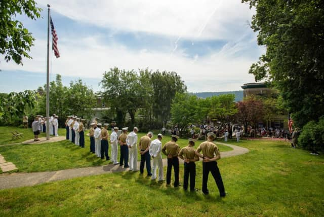 Sailors and Marines stand guard in front of the James Daly Post 200 VFW Hall at the Moment of Silence for Fallen Hero's at the Hastings on Hudson Memorial Day Parade