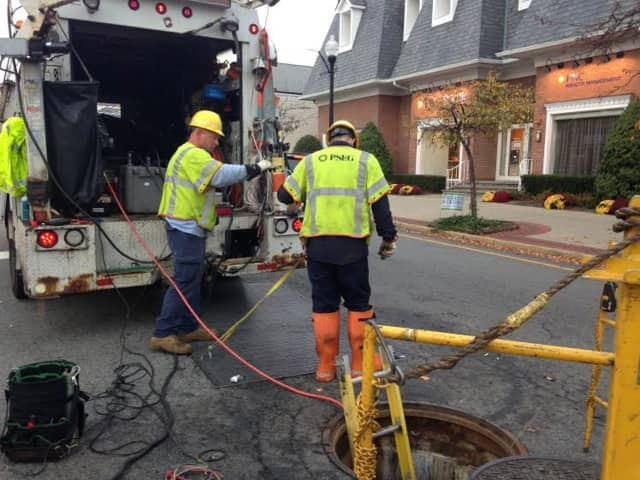PSE&G workers descended into the manhole to check the electrical system in Ridgewood on Nov. 5.