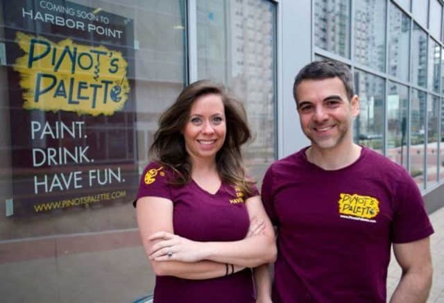 Pinot's Palette owners Chad M. Smith, right, and Joanne Christena Smith.