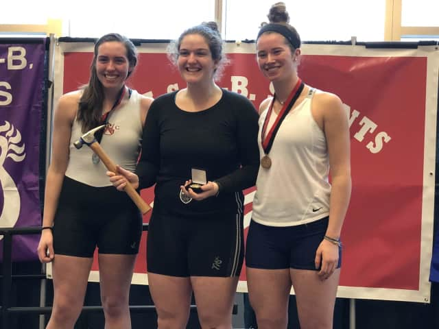 Sydney Kend, center, recently won gold in a prestigious indoor rowing competition.