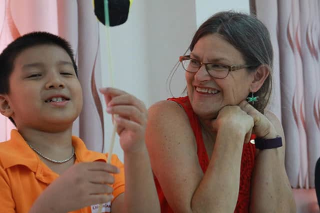 New Rochelle educator Elizabeth Barrett-Zahn teaching in Vietnam.