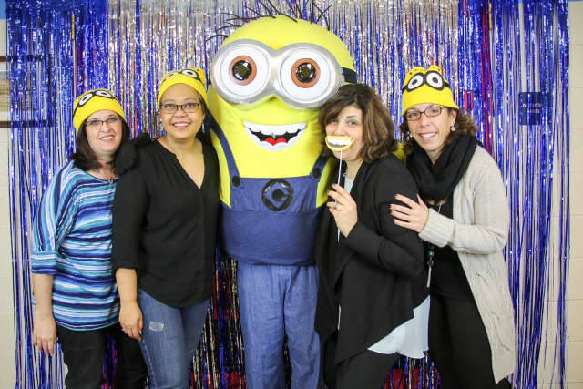 Lyncrest School fifth grade committee members (left to right) Jessica Tratner, Vivian Cardoso, Susan Quinlan and Alyssa Shacknow hang with special guest Bob the Minion in the photo booth.
