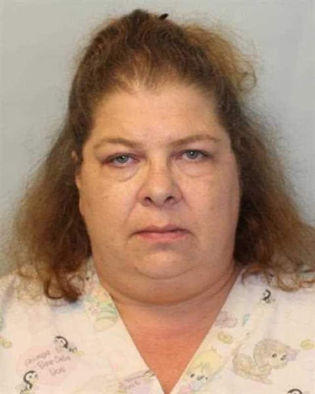 Stacy E. McAdams, 47