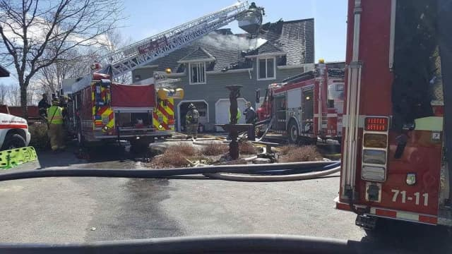 West Clinton firefighters battled a fire that destroyed half of a large multi-family home.