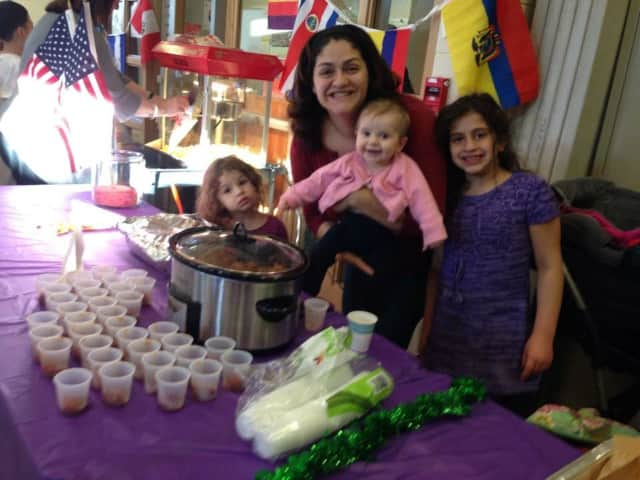 Anna Salerno with her daughters Bella, Amelia and Alexandra at her school's International Night Food Fair with hundreds of meatballs.
