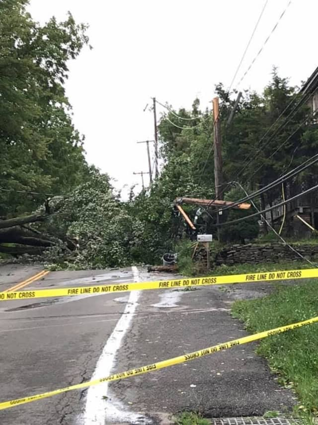 A fallen tree along Middlebush Road in the Town of Wappinger broke a pole and downed wires, caused by strong winds brought by Tropical Storm Isaias.