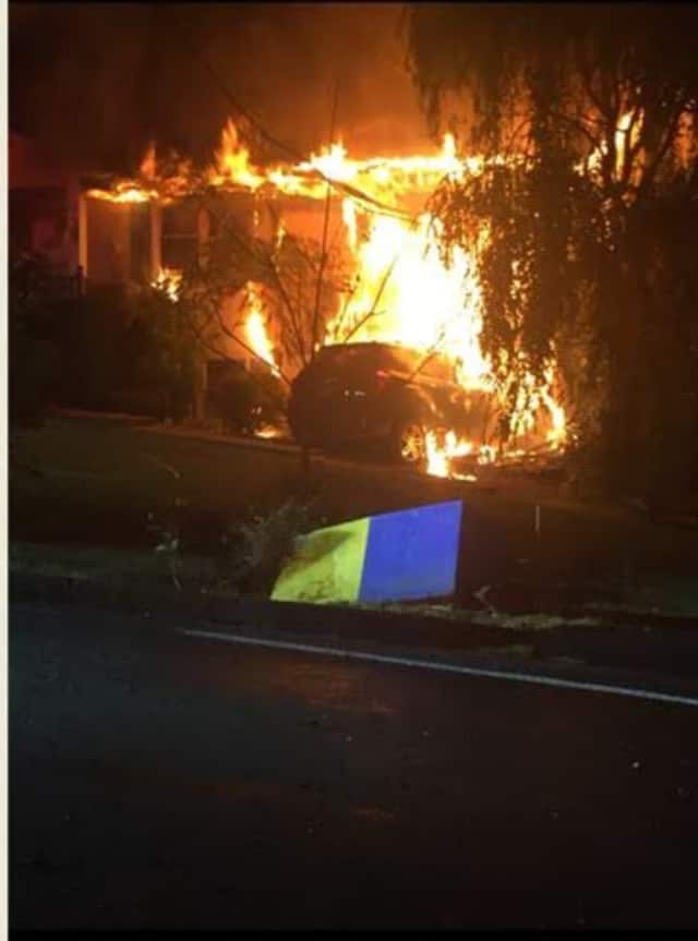 Pearl River firefighters battled a large fire after an SUV slammed into the home, hitting a gas main.