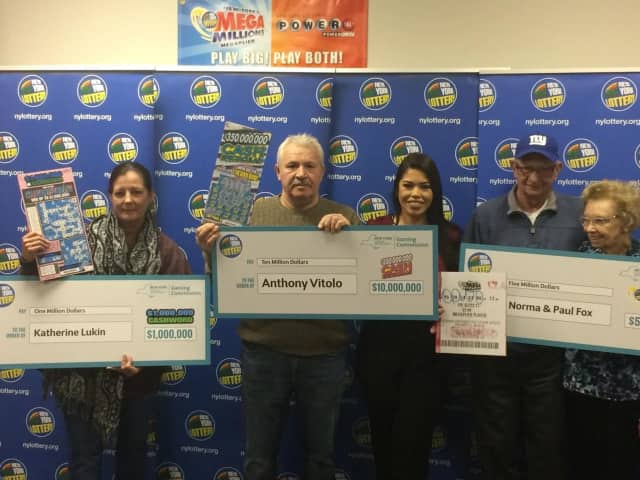The Hudson Valley's newest millionaires who off their winning tickets and checks.