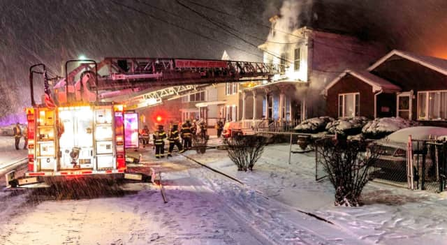 In the middle of a blizzard City of Poughkeepsie firefighters work to douse at house fire on Mansion Street.