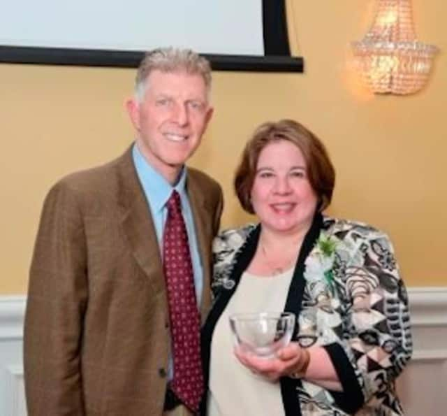 Michael Gargano Jr., president of St. Vincent's College, and Ann Ballas, the 2016 distinguished alumni award recipient.