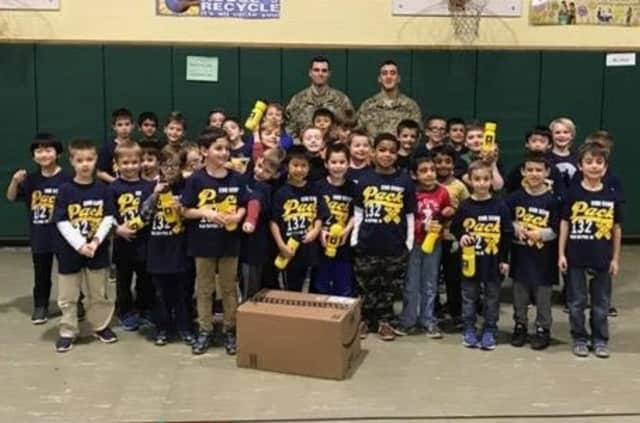 Old Tappan Cub Scout Pack 132 with U.S. Army soldiers and a care package the boys prepared for troops overseas.