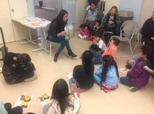 New Rochelle teachers are teaching parents to model classroom reading habits.